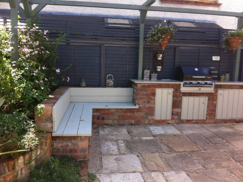 built in bbq made with reclaimed bricks curved rendered garden walls