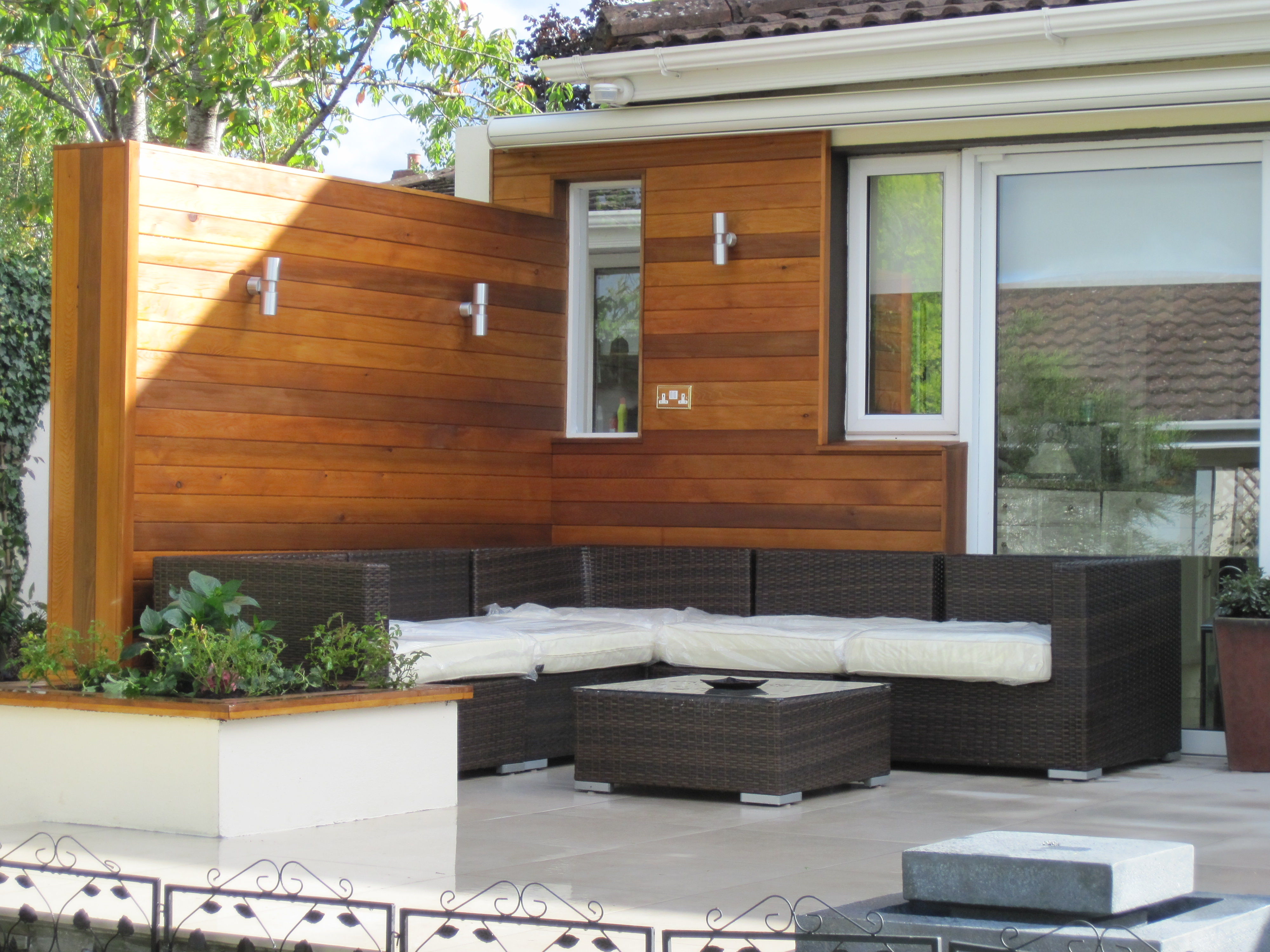 Cedar backdrop to cosy outdoor patio