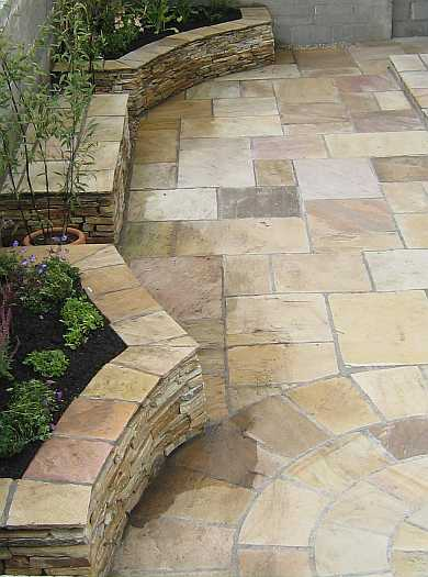 Sandstone Paving with Raised Flower Beds