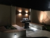 BBQ area with Built in Seating and decorative lighting