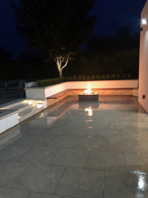 Gas Fire Pit and Built in Seating at Night