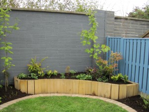 Garden Design with a Raised Sleeper Bed
