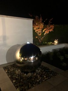 Steel Sphere Water Feature at night